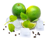 Two whole limes, one slice, lemon balm leaves, clear ice cubes and pepper isolated on white background. - 180170710