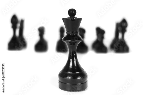 Plakat Black chess pieces on white background - isolated