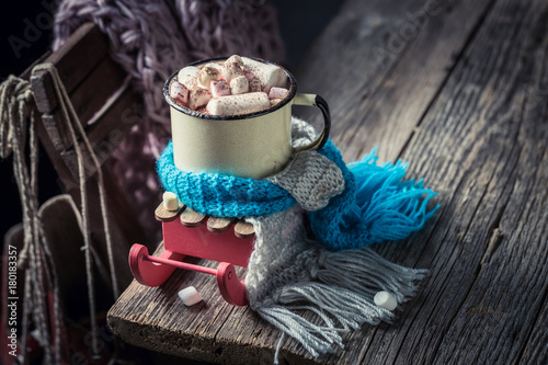 Foto op Canvas Chocolade Warming up chocolate with blue scarf for Christmas