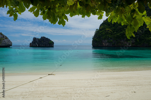 Foto op Canvas Tropical strand beautiful beach and sea with mountain background. Clear sea. Summer time. Relax on holidays. Travel