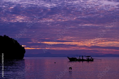 Foto op Canvas Zee zonsondergang beautiful beach and sea with silhouette boat.Clear sea. Summer time. Relax on holidays. Travel