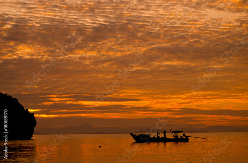 Fotobehang Zee zonsondergang beautiful beach and sea with silhouette boat.Clear sea. Summer time. Relax on holidays. Travel