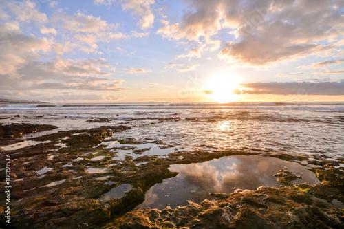 Foto op Canvas Zee zonsondergang The Sun Setting in the Sea