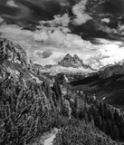 Dynamic surreal clouds running over the Tre Cime di Lavaredo, in the Italian Alps black and white
