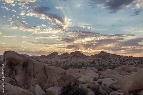 Fotobehang Donkergrijs Rocky Cloudy Desert Sunset Lanscape