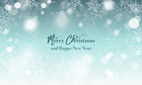 Merry Christmas and Happy New Year wishes. Blurred vector background with snowflakes and glowing elements. - 180204749