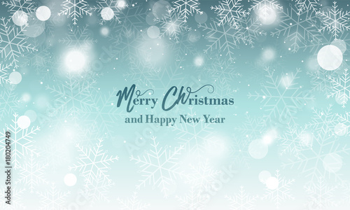 Merry Christmas and Happy New Year wishes. Blurred vector background with snowflakes and glowing elements.