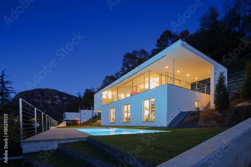Fridge magnet Modern villa, exterior in the night, lights on