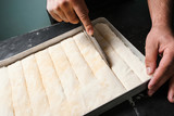 Food pastry. Baker works with dough. Recipe and cooking concept - 180214581