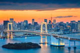 Tokyo. Cityscape image of Tokyo, Japan with Rainbow Bridge during sunset. - 180218585