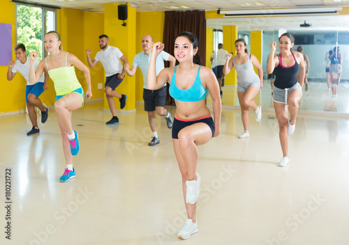 slim athletic women and men  dancing strip plastic in class