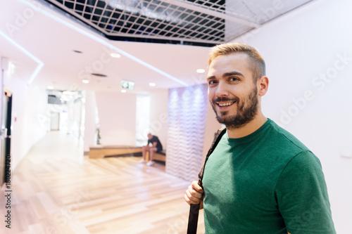 Wall mural Sportive man in a modern gym interior.