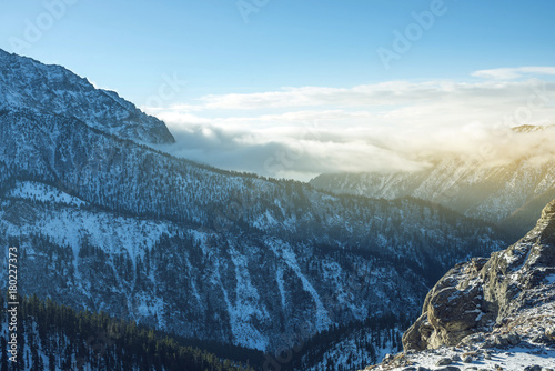 Aluminium Landschappen Beautiful view of the mountain peaks of the Baikal mountains in the snow at sunrise. Concept of travel and Hiking trips