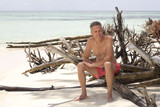 mature man alone on an atoll in raja ampat archipelago - 180231956