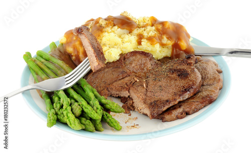 Fotobehang Steakhouse Fried venison steak meal with mashed potatoes and asparagus isolated on a white background