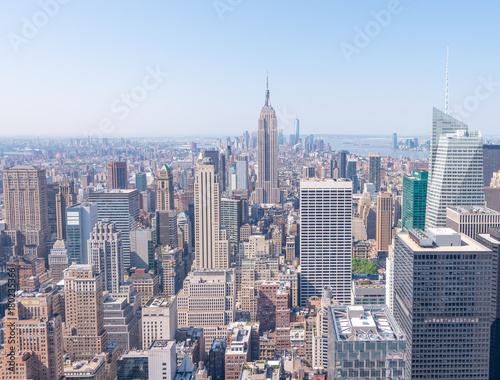 NEW YORK CITY - JUNE 9, 2013: Aerial view of Midtown skyscrapers. New York attracts 50 million tourists every year