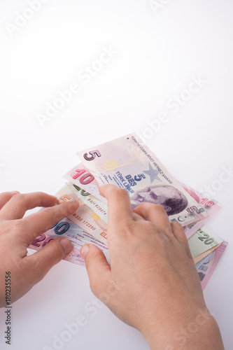 Poster Hand holding Turksh Lira banknotes  in hand