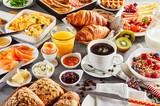 Huge healthy breakfast spread on a table