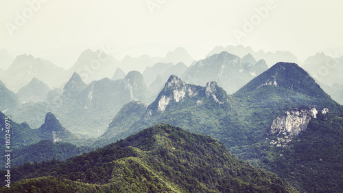 Foto op Plexiglas Wit Retro toned picture of karst formations landscape around Guilin on a foggy day. It is one of China most popular tourist destinations.