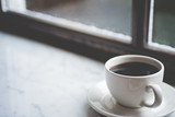 Coffee Cup in a Window Sill
