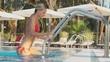 Sexy woman portrait in bikini getting out of swimming pool