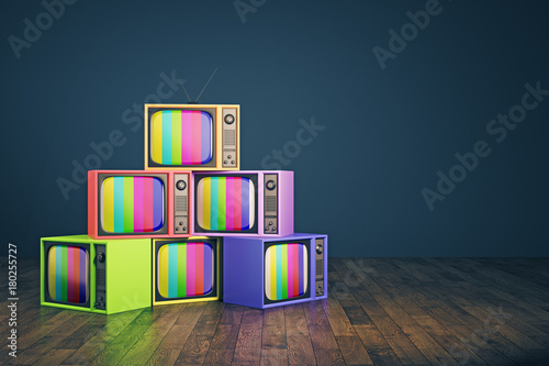 Old rainbow TV pile