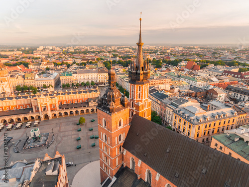Market Square from above, aerial view of old city center view in Krakow at morning time, main square, famous cathedral in sun light, Poland