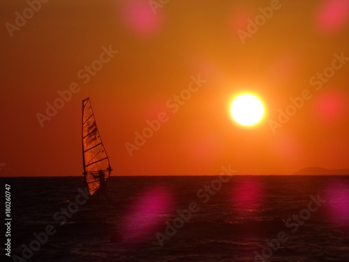 Papiers peints Orange eclat Sailing at sunset orange sky