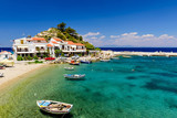 The picturesque village of Kokkari with traditional houses and fishing boats. Kokkari village is a popular tourist place on the island of Samos. - 180267502