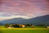 Breathtaking lansdcape of Austrian countryside on sunset. Dramatic sky over idyllic green fields of Anstrian Central Alps on autumn evening. - 180285598