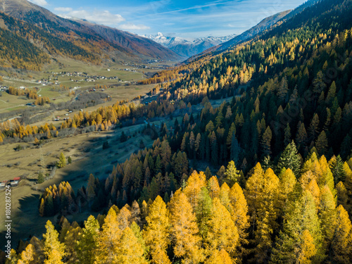 Fotobehang Oranje Aerial view of mountain valley in Switzerland. Fall colors during indian summer