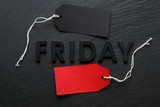 Black Friday text with red sale tag on slate background - 180293180