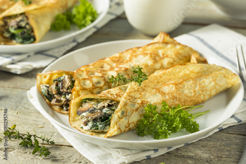 Savory Homemade Mushroom and Spinach Crepes - 180295746