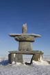 Inuksuk or Inukshuk found near Churchill, Manitoba  in late October with snow on the ground