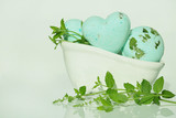 Mint bath bomb. green bath bombs with mint extract in a small bath and twigs of  mint . Cosmetics for bath. - 180310561