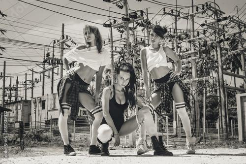 three hot young girls hip-hop dancers outdoors