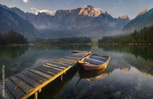 Plexiglas Pier wooden bridge over a mountain lake