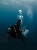 Scuba diver with bubbles - 180321337