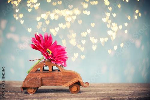 Fotobehang Gerbera Blumengruß mit dem Auto