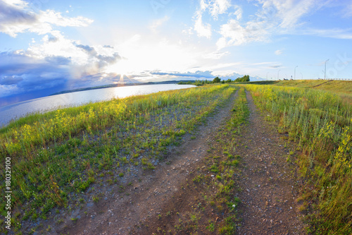 Fotobehang Lente paved country road with beautiful sky