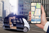 Fototapety Control of self driving bus by mobile app. Hand with phone on a background of autonomous vehicle with open door.