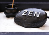 stone with the inscription Zen - a symbol of peace and balance - 180332190
