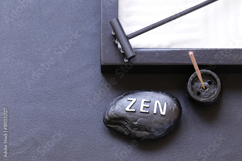 Foto op Canvas Stenen in het Zand stone with the inscription Zen - a symbol of peace and balance
