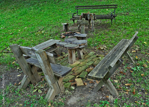 Fotobehang Groene Wooden table and benches in for relax in park