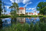 Neo-Gothic style palace surrounded by an English landscape garden in Wojanow, Poland - 180344716