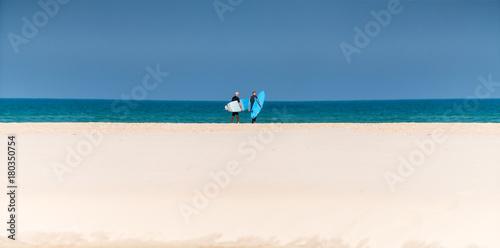 men surfers on the seashore Poster