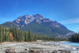 Rocky Mountains in Canada with creek bed in foreground