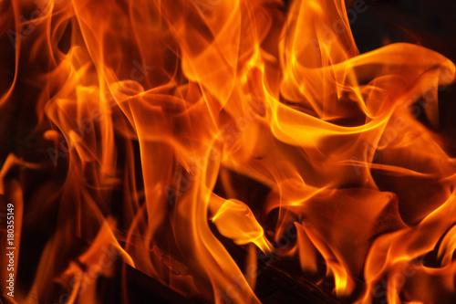 Deurstickers Brandhout textuur fire flame close-up background texture. bonfire
