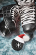 Hockey men's skates and washer with a cap of Santa close-up