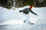 Snowboarder In Action - 180377700